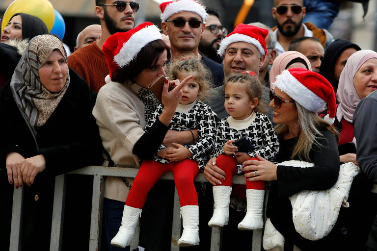 People attend Christmas celebrations at Manger Square outside the Church of the Nativity in Bethlehem, in the Israeli-occupied West Bank