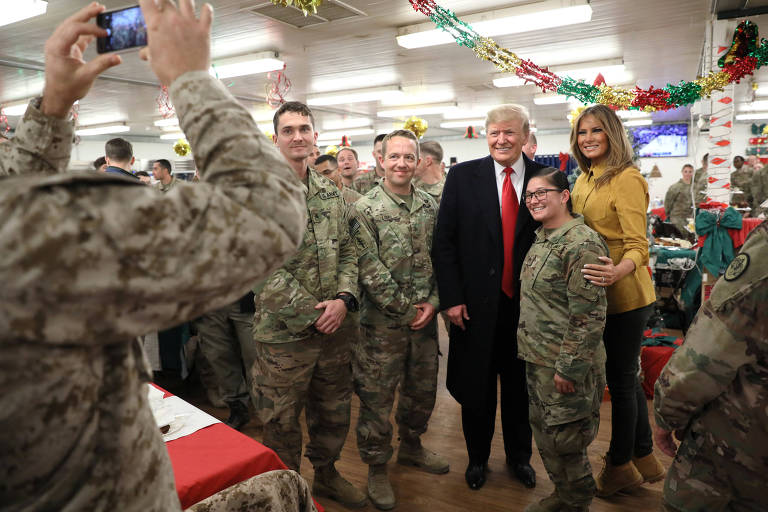 U.S. President Trump and the First Lady greet military personnel at the dining facility during an unannounced visit to Al Asad Air Base, Iraq