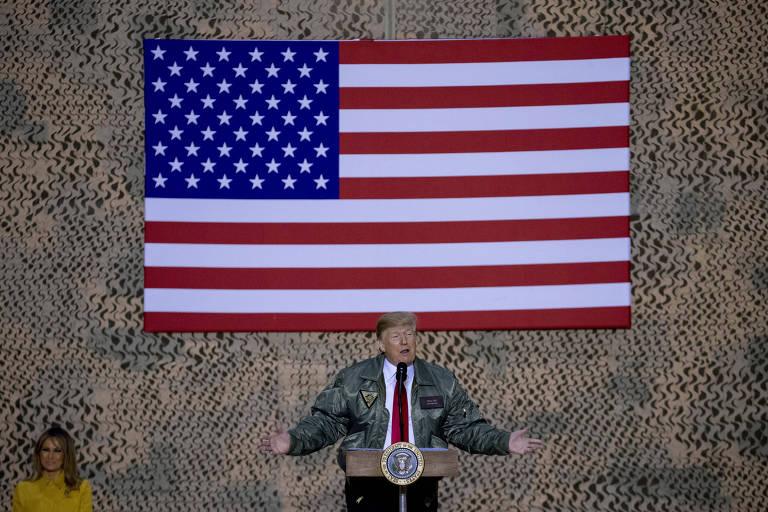 O presidente Donald Trump e a primeira-dama, Melania, durante visita às tropas americanas no Iraque