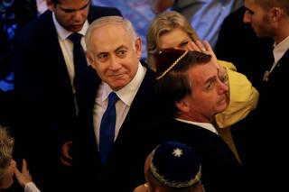 Israeli PM Netanyahu and Brazil's President-elect Bolsonaro leave a synagogue in Rio de Janeiro