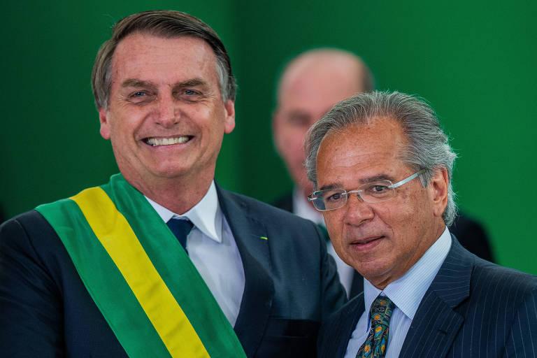 9 O presidente da República Jair Bolsonaro (PSL) e Paulo Guedes, ministro da Economia, durante cerimônia de posse do seu primeiro mandato, no Palácio do Planalto, em Brasília (DF)