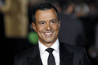 FILE PHOTO: Agent Jorge Mendes poses for photographers on the red carpet at the world premiere of