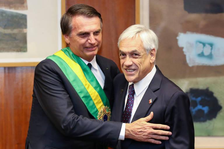 Durante sua posse em Brasília, Jair Bolsonaro cumprimenta o presidente do Chile, Sebastián Piñera