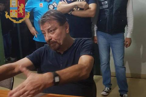 A handout picture handout by the Italian State Police (Polizia di Stato) released on January 13, 2019 shows former far-left Italian militant Cesare Battisti after he was arrested late on January 12, 2019 in the Bolivian city of Santa Cruz de la Sierra. - Cesare Battisti, a former Italian militant captured in Bolivia, will make a stopover in Brazil before he is extradited to Italy where he is wanted for murder, a key cabinet minister said on January 13.
