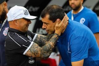 Os técnicos Jorge Sampaoli e Fábio Carille