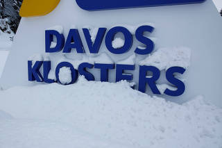The logo of Davos Klosters is seen at the entrance to Davos