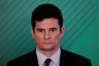 Brazil's Justice Minister Sergio Moro looks on during a signing ceremony of the decree which eases gun restrictions in Brazil, at the Planalto Palace in Brasilia