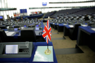A Union Jack flag is seen on the desk of a MEP ahead of a debate on BREXIT at the European Parliament in Strasbourg
