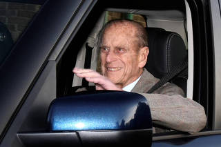 FILE PHOTO: Britain's Prince Philip is driven away from Papworth Hospital in southern England