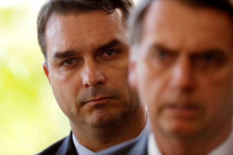 FILE PHOTO: Flavio Bolsonaro, son of Brazil's President Jair Bolsonaro is seen behind him at the transition government building in Brasilia, Brazil November 27, 2018. REUTERS/Adriano Machado/File photo ORG XMIT: SMS201