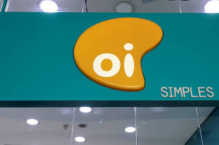 FILE PHOTO: The logo of Brazilian telecoms company Oi SA is pictured inside a store in Sao Paulo