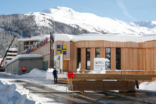 Snow-covered mountains are seen behind the congress centre, the venue of the World Economic Forum in Davos