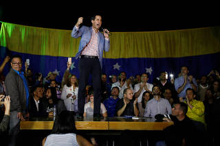Juan Guaido, President of Venezuela's National Assembly, greets supporters during a gathering in Caracas