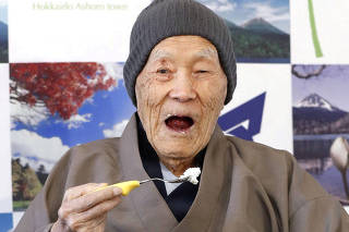 FILE PHOTO: Japanese Masazo Nonaka, who was born 112 years and 259 days ago, eats his favorite cake as he receives a Guinness World Records certificate naming him the world's oldest man during a ceremony in Ashoro