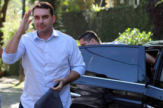 FILE PHOTO: Flavio Bolsonaro, son of Jair Bolsonaro, far-right lawmaker and presidential candidate of the PSL, salutes as he arrives to record an electoral program for television in Rio de Janeiro