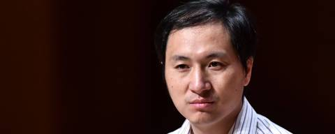 In this picture taken on November 28, 2018, Chinese scientist He Jiankui reacts during a panel discussion after his speech at the Second International Summit on Human Genome Editing in Hong Kong. - A scientist who upended a Hong Kong conference with his claim to have created the world's first genetically-edited babies cancelled a fresh talk and was heavily criticised by organisers on November 29, who labelled him as irresponsible. (Photo by Anthony WALLACE / AFP)