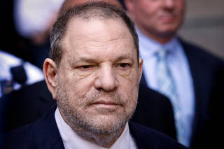 FILE PHOTO - Film producer Harvey Weinstein leaves a court in the Manhattan borough of New York