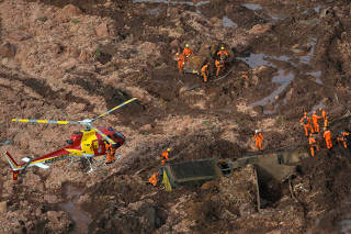Rescue crew work in a dam owned by Brazilian miner Vale SA that burst, in Brumadinho