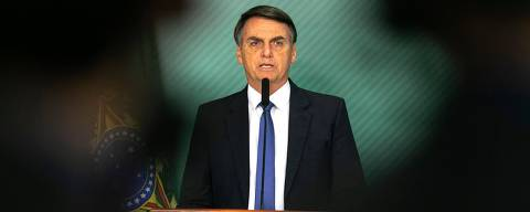 Brazilian President Jair Bolsonaro gives a statement in Brasilia on January 25, 2019 after the collapse of a dam near Brumadinho in southeastern Brazil. - A dam collapse in southeastern Brazil unleashed a torrent of mud on a riverside town and surrounding farmland Friday, destroying houses, leaving 200 people missing and raising fears of a number of deaths, according to officials. The dam belonged to Brazilian mining giant Vale. (Photo by Sergio LIMA / AFP) ORG XMIT: SLI