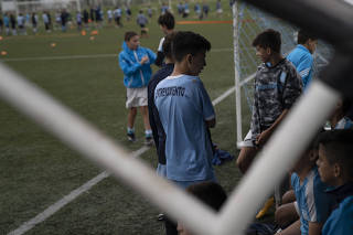 Young players at the Predio Tita Mattiussi, where Racing Club de Avellaneda?s soccer players train, in Buenos Aires, Argentina.