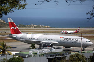 A plane from Russian company Nordwind is seen at Simon Bolivar Airport in Caracas