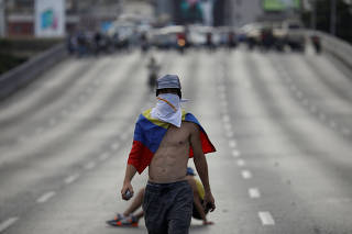 An opposition supporter is seen on a street on a day of a rally against Venezuelan President Nicolas Maduro's government in Caracas