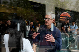 FILE PHOTO: Apple CEO Tim Cook visits an Apple store in Shanghai