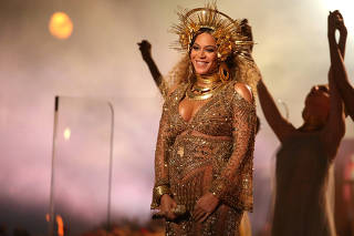 FILE PHOTO: Beyonce performs at the 59th Annual Grammy Awards in Los Angeles