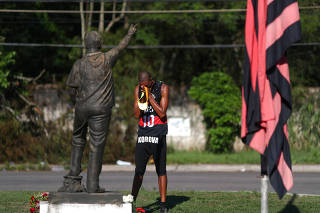 A Flamengo's soccer fan reacts in front of the club's training center, after a deadly fire, in Rio de Janeiro