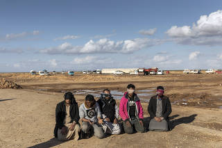 Men who had been arrested by Syrian Democratic Forces soldiers over suspected links to the Islamic State are held in Deir al-Zour province, Syria, on Jan. 30, 2019.