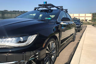 FILE PHOTO: An Aurora self-driving Lincoln MKZ car is seen outside the company?s office in the Lawrenceville neighborhood in Pittsburgh
