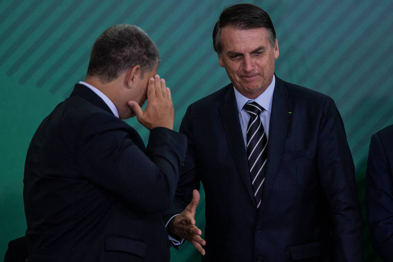 O presidente Jair Bolsonaro participa de evento com Gustavo Bebianno (Secretaria-Geral), no Palácio do Planalto, em Brasília. Ministro está sob pressão no governo