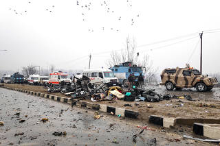 Indian soldiers examine the debris after an explosion in Lethpora in south Kashmir's Pulwama district