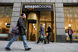 People walk past an Amazon Books retail store in New York
