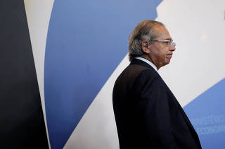 Brazil's Economy Minister Paulo Guedes attends an event in Brasilia