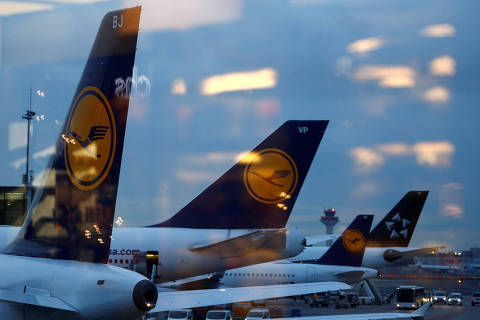 Tail wings of planes of German air carrier Lufthansa are seen from a cafe bar at the airport in Frankfurt, Germany, February 12, 2019.  REUTERS/Kai Pfaffenbach ORG XMIT: FFF-KAI03
