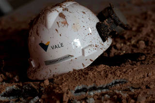 FILE PHOTO: A helmet with a logo of Vale SA is seen in a collapsed tailings dam owned by the company, in Brumadinho