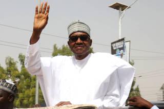 FILE PHOTO: Nigeria's President Muhammadu Buhari leaves after attending Friday prayers in his hometown Daura in Katsina State