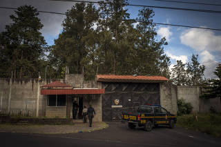 Officials arrive on Oct. 30, 2018, at the entrance to the youth shelter  in San Jose Pinula, near Guatemala City, where 41 girls died in a February 2017 fire.