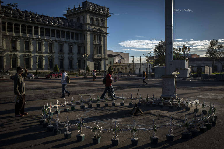 A man in Guatemala City stops on Oct. 30, 2018, to look at a memorial to the victims and survivors of a fire at a youth shelter. Nearly two years later, the trials against public officials accused of failing to prevent the deaths have all begun. (Daniele Volpe/The New York Times)