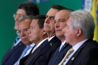FILE PHOTO: Levy, Guedes, Mourao, Bolsonaro, Lorenzoni and Novaes attend ceremony at Planalto Palace in Brasilia
