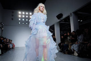 A model presents creations during the Bora Aksu show at London Fashion Week Women's A/W19 in London