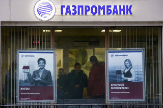 FILE PHOTO: File photo of people visiting a branch of Gazprombank in Moscow