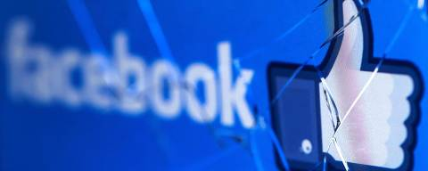 (FILES) In this file photo taken on May 16, 2018, the logo of the social network Facebook on a broken screen of a mobile phone is seen in Paris, France. - Facebook's woes mounted Wednesday, December 19, 2018 as it faced a lawsuit alleging privacy violations related to data leaked to a consultancy working on Donald Trump's 2016 campaign, and as a new report suggested it shared more data with partners than it had said. The suit filed by the District of Columbia attorney general is likely the first by an official US body that could impose consequences on the world's leading social network for data misuse. (Photo by JOEL SAGET / AFP) ORG XMIT: 25579