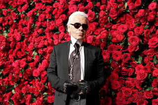 FILE PHOTO - German fashion designer Lagerfeld attends the Museum of Modern Art's fourth annual Film Benefit in New York