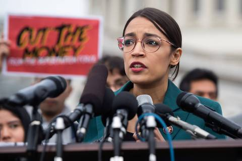 US Representative Alexandria Ocasio-Cortez, Democrat of New York, speaks during a press conference calling on Congress to cut funding for US Immigration and Customs Enforcement (ICE) and to defund border detention facilities, outside the US Capitol in Washington, DC, February 7, 2019. (Photo by SAUL LOEB / AFP) ORG XMIT: SAL008