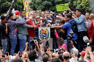 Venezuela's opposition leader Guaido attends a protest of the public transport sector against the government of Venezuela's President Nicolas Maduro in Caracas