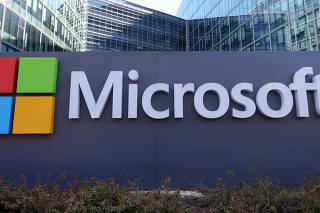 FILE PHOTO: General view of Microsoft's logo at Microsoft Corporation headquarters at Issy-les-Moulineaux, near Paris