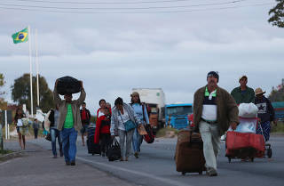 People walk after crossing the border from Venezuela to Brazil in Pacaraima