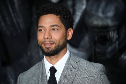 (FILES) In this file photo taken on May 4, 2017 US actor Jussie Smollett poses for a photograph upon arrival at the world premiere of